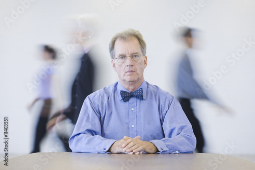 Businessman with hurried colleagues