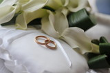 bride bouquet and wedding rings