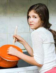 Teen girl with pan