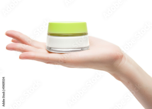 woman hand with cream pot