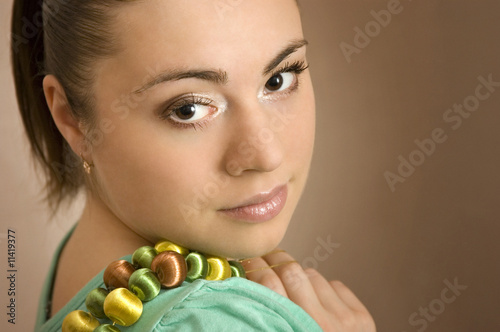 The beautiful young woman with a beads