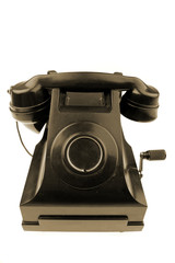 Old black telephone isolated on white background