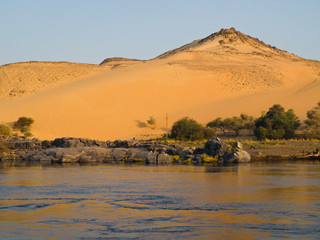 Sand dune view from a boat on Nile river. Egypt series