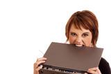 Frustrated Caucasian businesswoman biting laptop