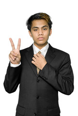 Young Indian businessman making V-sign