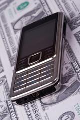 cellphone on money background