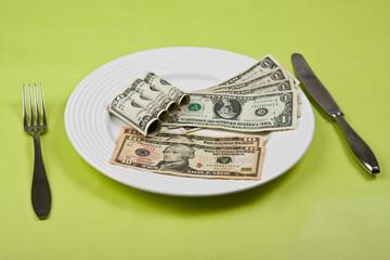 money on plate