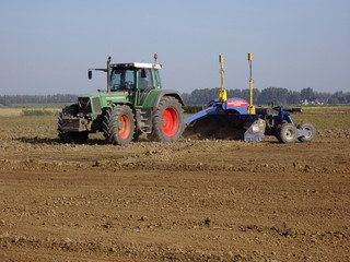 tractor shovel plough working at land