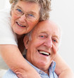 Closeup portrait of a happy older couple hugging