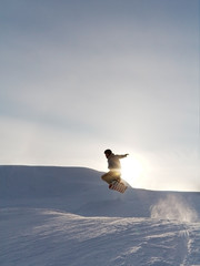 snowboarder's jump at the sunset