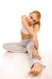 Portfait of Sporty beautiful girl stretching on white poster