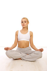 Portfait of Sporty beautiful girl sitting in yoga position