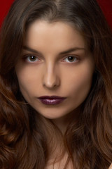 Young beautiful woman with violet lips
