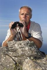 Explorer with is binoculars looking for adventure