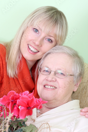 Photo of old lady with young woman