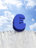 Euro symbol falling from edge of cliff