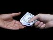 Hands exchanging one hundred dollar bills