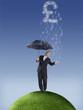British pound symbol raining on businessman with umbrella