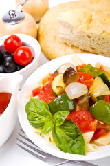 penne pasta with vegetables, basil, olives and foccacia bread