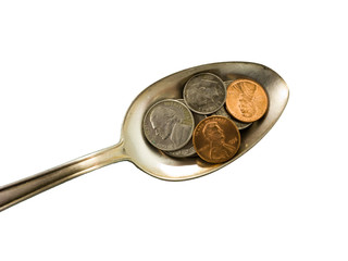 Heaping spoonful for the world economy, closeup.