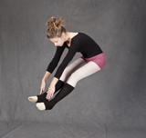 dancer jumping and touching toes poster