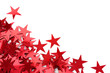 Red stars confetti on white background