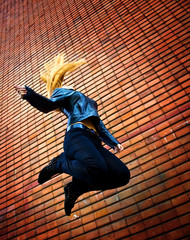 Young energetic woman jumping