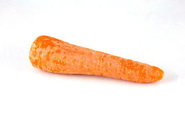 Washed carrot on white background