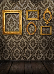 Gold frames, retro wallpaper, spotlights from above