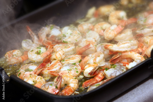 Fototapeta The photograph of fried seafood on the frying pan (shrimps)