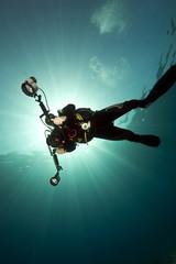 ocean, sun and diver