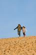 s'élancer du haut de la dune