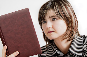 girl looks at a book
