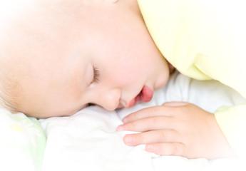 Restful baby boy sleeping on bed