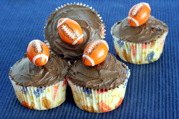 Chocolate cupcakes with footballs