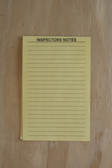 Inspection notes against plywood wall