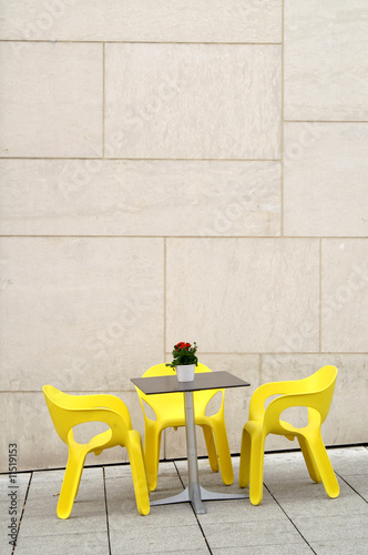 Yellow chairs in a street cafe