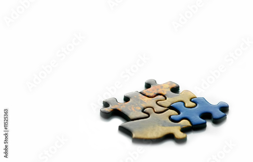 poster of incorrect piece in a jigsaw; teamwork or creativity concept