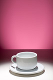 empty coffee cup with magenta background poster