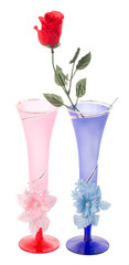 two wedding flutes and plastic rose