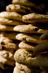 Two stacks of cookies  on black background in vertical crop