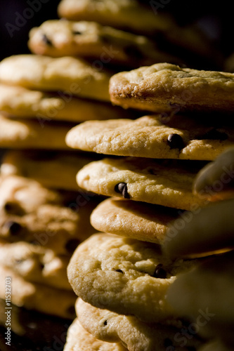Two stacks of cookies  on black background in vertical crop