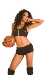 Sexy basketball player sporty female with ball