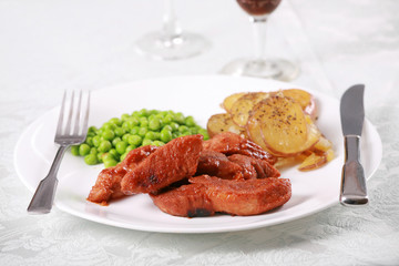 Plate of barbequed pork