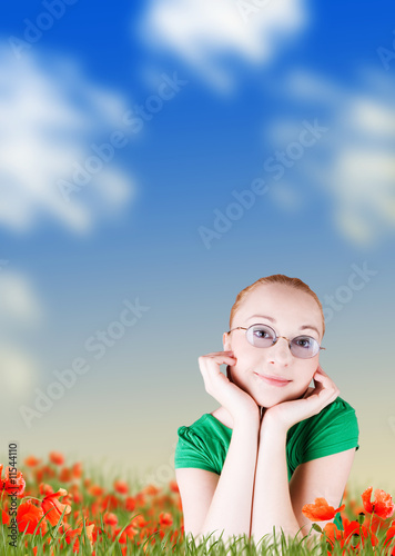 happy woman lying on poppy flowers field