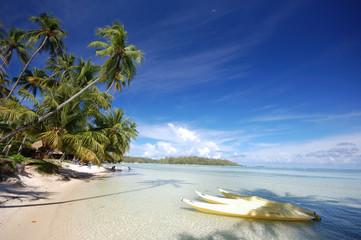Yellow kayaks, white sand beach, Moorea, French Polynesia