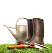 Garden boots with tool and watering can