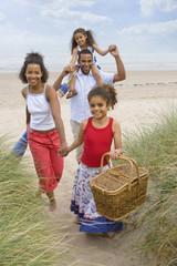 Portrait of family walking on beach
