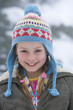 Portrait of young girl in winter hat