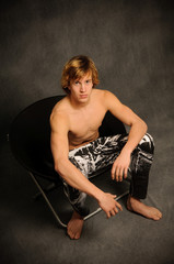 Teen Male Seated Shirtless